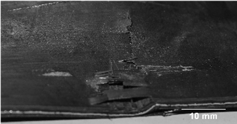 Durch Impact geschädigtes Faser-Metall-Laminat.